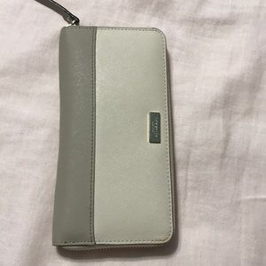 Kate Spade wallet new but has slight mark on cloth